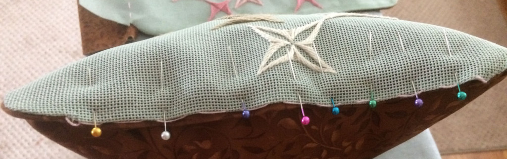 Ready to close (hand stitch) fourth side of the pillow.