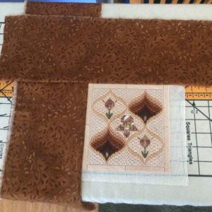step 4 stitch along worked design edge corner to corner